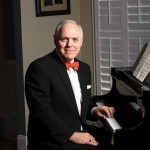Michael A. Milton at the piano