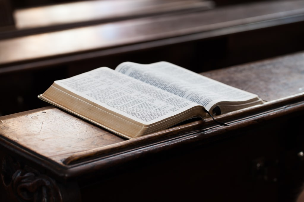 Open Bible on a church bench