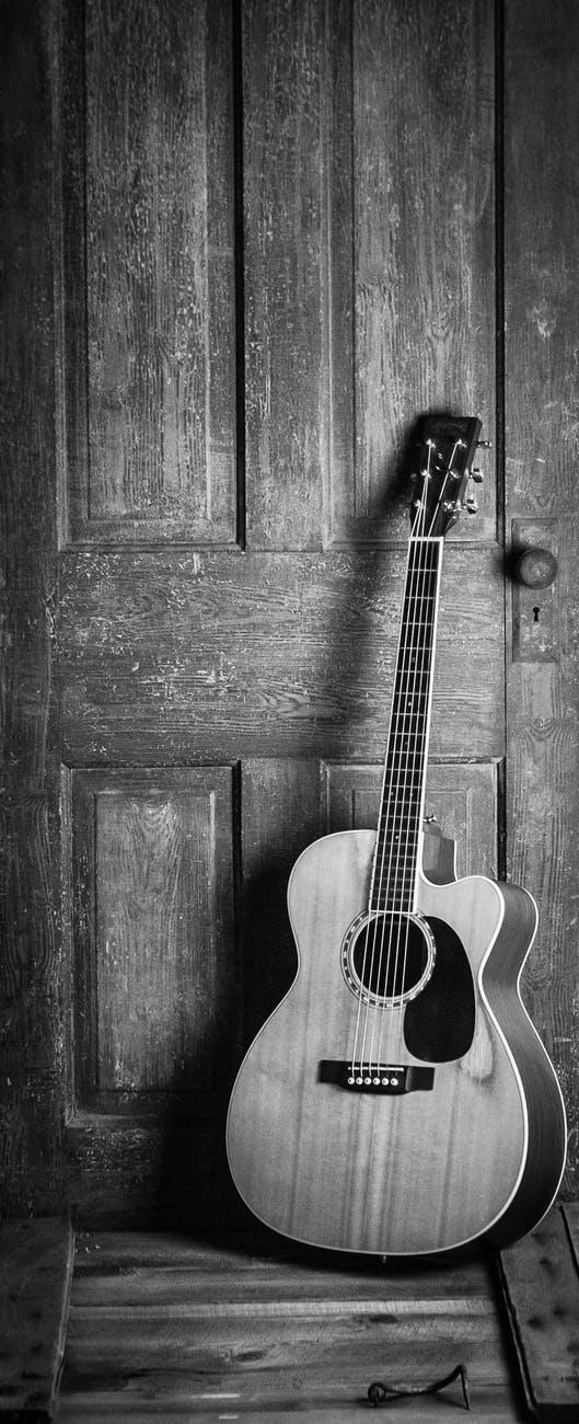 brown and black cut away acoustic guitar